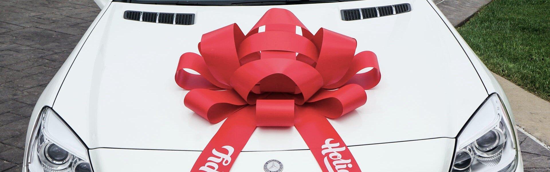 happy holidays car bow