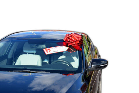 red pull bow with gift tag