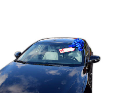 pull bow and gift tag on car