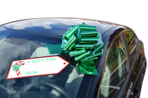 green pull bow on car windshield