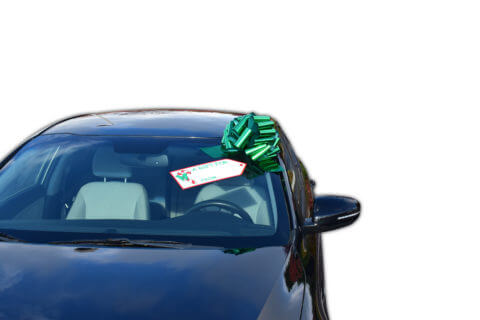 car bow on display with gift tag