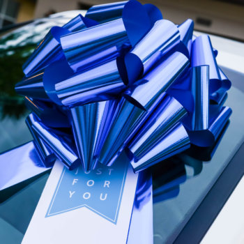 giant gift bow with a gift tag