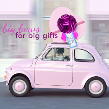 pink bow with gift tag on toy car